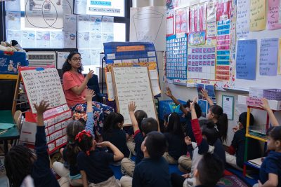 Neag School student leading a class at Kennelly Elementary School.
