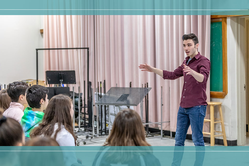 Music ed student leads class of young local students.